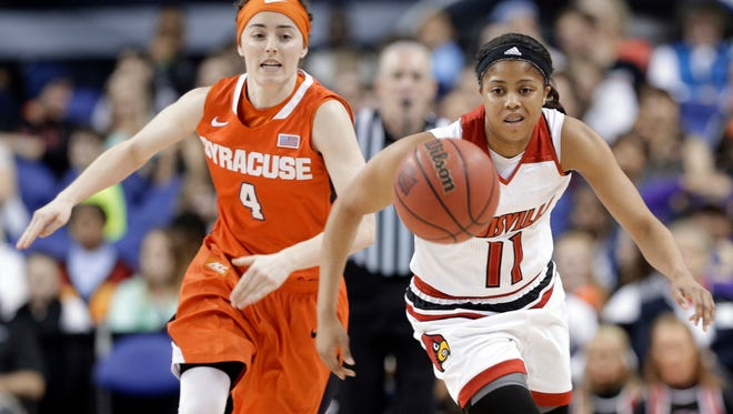 Louisville's Arica Carter (11) and Syracuse's Maggie Morrison (4) chase a loose ball during the first half of an NCAA college basketball game in the Atlantic Coast Conference tournament in Greensboro, N.C., Saturday, March 5, 2016.