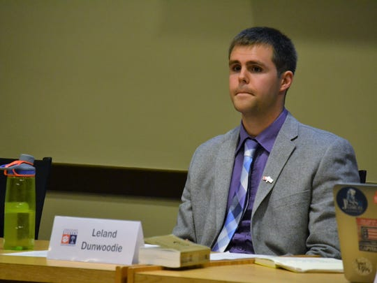 Leland Dunwoodie, president of Clemson University's student senate, listens to students debate whether or not to hold a trial to impeach Jaren Stewart, the student government vice president.