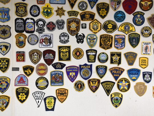 Police patches from all over the country line the walls