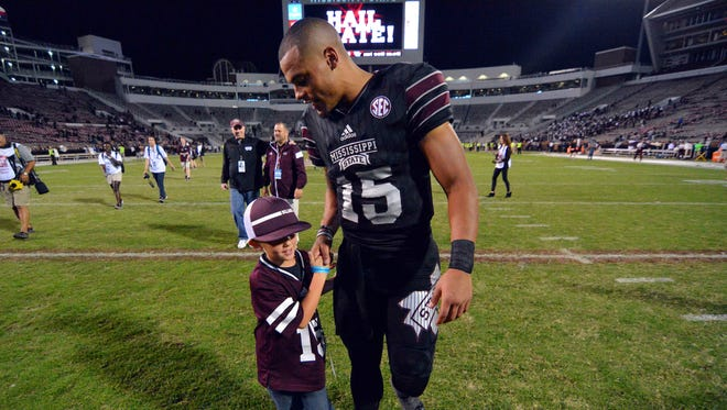 Mississippi State quarterback Dak Prescott  shakes hands with Noah Fortenberry after the game against the Kentucky Wildcats at Davis Wade Stadium last weekend.