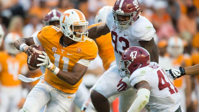 Tennessee quarterback Joshua Dobbs (11) is pressured by Alabama defensive lineman Jonathan Allen (93), center, and linebacker Christian Miller (47) on Oct. 15, 2016.