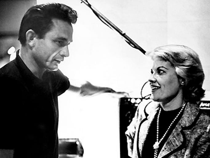 Recording stars Patti Page, right, and Johnny Cash meet for the first time at Owen Bradley's studios in Nashville and exchange a few secrets of the trade. Page had a one-night session at the studios and Cash was visited the Opry. Staff photo by Jack Corn (The Tennessean) 6/9/1962