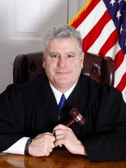 Mark Beauchat has served as judge in District Court