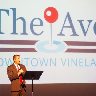 Robert Scarpa speaks during a rebranding event held