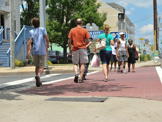 Pedestrians crossing at North division Street and Baltimore