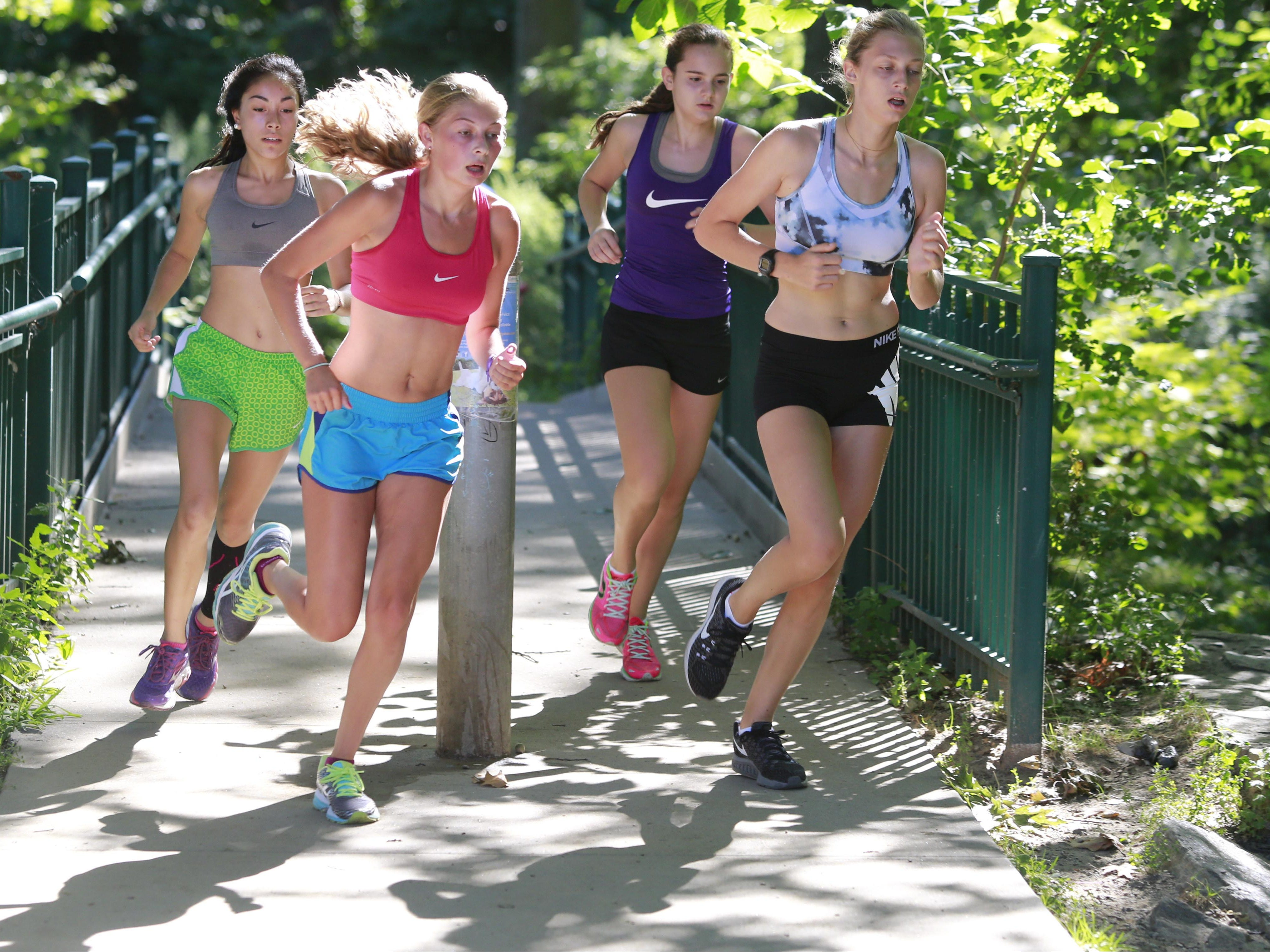 Members of the Bronxville Cross Country team train at Scout Field in Bronxville on Aug. 23, 2016.