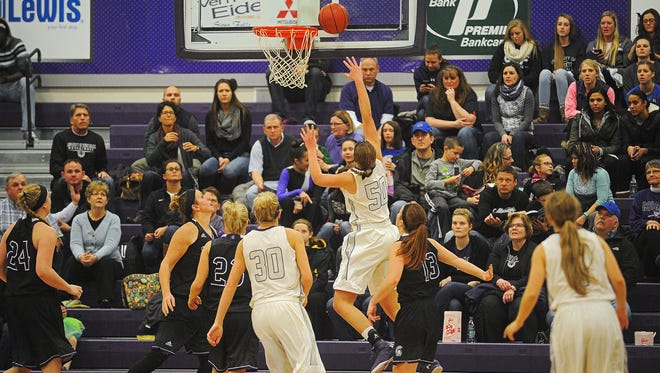 USF's Sam Knecht (50) goes up for a shot during a game against Winona State Friday, Jan. 8, 2016, at the University of Sioux Falls Stewart Center in Sioux Falls.