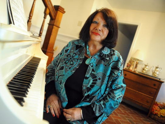 Judy Hatcher sits at her piano in her Staunton home