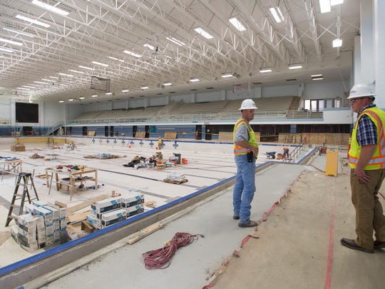 Robert Rigg, superintendent, and Ethan Cozzens, facility project manager, tour the ongoing renovations of the pools in EPIC Thursday, September 22, 2016.