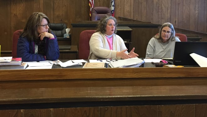 Members of the Marion County Election Commission (from left) Suzanne Shipman, Karen Carter and Elaine Ryder discuss the prospect of adopting voting centers on Friday at the Marion County Courthouse.