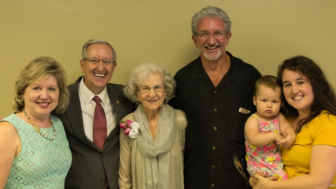 Vestal Humphreys Phelps, center, with her family at her 90th birthday reception. Pictured are, from left, daughter-in-law Robbin Phelps, sons Dennis Phelps and Dwight Phelps and granddaughter Kristen Phelps Williams holding Addyline Williams, her great-granddaughter.