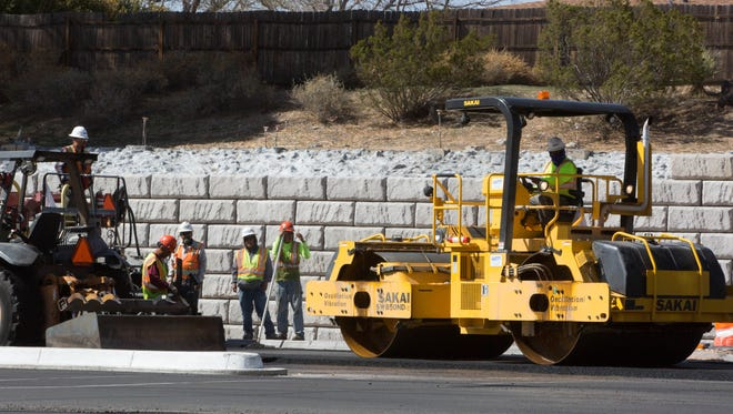 Workers make progress on the intersection at Three Crosses, North Main and Solano, Thursday March 15, 2018.