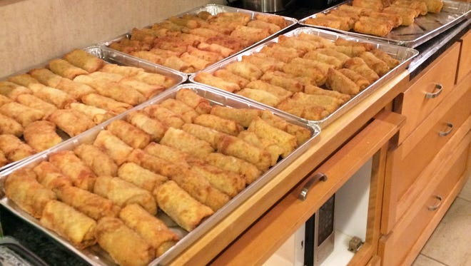Dozens of egg rolls are made for the Hwangs' annual fundraiser for MS.