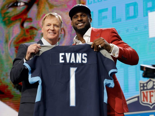 Commissioner Roger Goodell, left, presents Alabama's Rashaan Evans with his Titans jersey during the first round of the NFL draft Thursday in Arlington, Texas.
