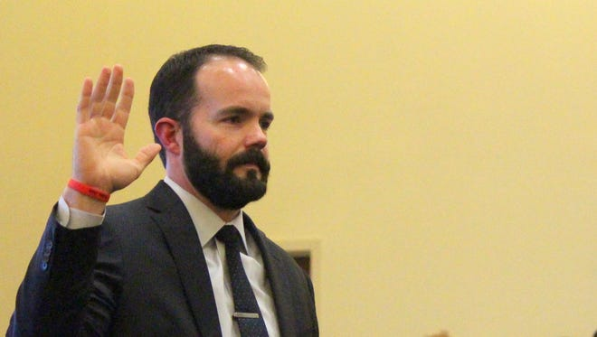 The Honorable Judge Jarod K. Hofacket, left, is ceremonially sworn in to his new position on the bench of the Sixth Judicial District Court by Justice Judith Nakamura of the New Mexico Supreme Court. Hofacket was recommended by the state central Republican Party in October and was officially sworn into the position in November. A small reception was held for friends and family after the ceremony Thursday.