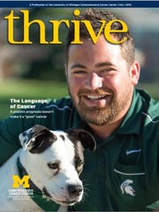 Marcus Calverley and his dog, Griswold, are on the cover of the fall edition of Thrive magazine, which is produced by the University of Michigan Comprehensive Cancer Center.