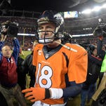 Denver quarterback Peyton Manning (18) walks off the field after the NFL divisional playoff game against the Indianapolis Colts at Sports Authority Field at Mile High Stadium. Manning will return next season.