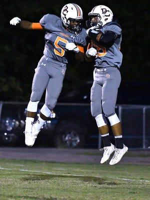 Demontez Coleman and Trey Wiedman celebrate a Dickson County touchdown.