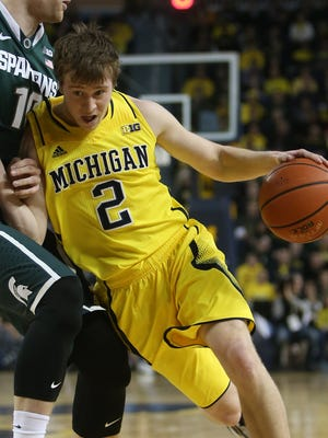 Michigan's Spike Albrecht drives against Michigan State's Matt Costello during the first half on Feb. 17 at Crisler Center.
