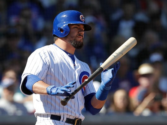 FILE - In this Feb. 27, 2018, file photo, Chicago Cubs' Kyle Schwarber bats during the first inning of the team's spring training baseball game against the Chicago White Sox in Mesa, Ariz. Stung by a disappointing season, Schwarber stepped up his workouts over the winter, embraced a new diet and lost about 20 pounds. The catcher-turned-outfielder looks faster and more agile this spring, a positive sign as he tries to return to form after struggling for much of last year. (AP Photo/Carlos Osorio, File)