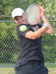 Luke Webster hits a return to his cousin Jansen Webster