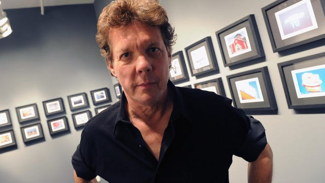 Steve Forbert poses with his pictures at a gallery in Nashville.