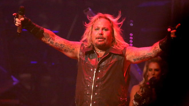Vince Neil performs with Motley Crue.