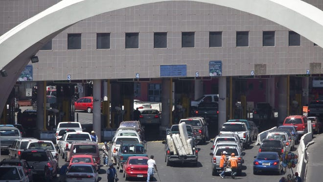 This file photo shows vehicles waiting to enter the U.S. through The Dennis DeConcini Port of Entry in downtown Nogales, Ariz. A Customs and Border Protection officer shot and wounded the driver of a vehicle attempting to enter Mexico at a crossing in Arizona, the agency said Friday.