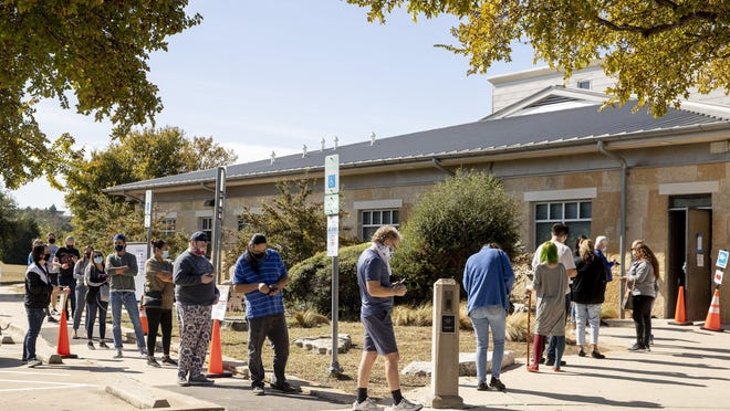 People wait in line to vote at the Dan Ruiz Branch Library on Tuesday November 3, 2020.