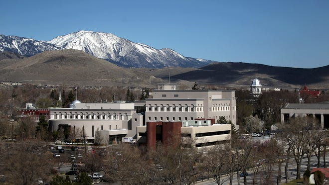 This April 4, 2012, photo released by the city of Carson City shows the downtown area, including the state Capitol building at right, in Carson City.
