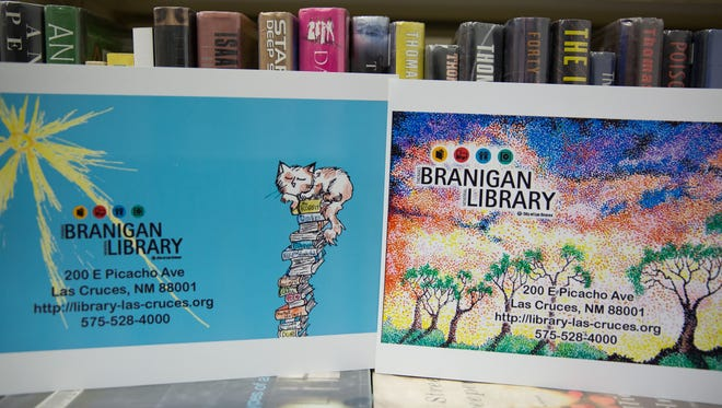 Winning designs of Thomas Branigan Memorial Library's Design the Library Card Contest.  Rose Moon Longo designed the youth card, left, and Tiffany Castle designed the adult library card.