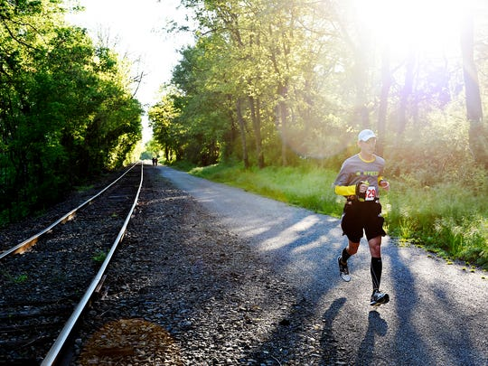 A participant runs the York Marathon near the Seven Valleys intersection of the York County Heritage Rail Trail Sunday, May 15, 2016. The race, run by the YMCA of York and York County, is run mostly on the York County Heritage Rail Trail and is certified as a Boston Marathon Qualifier. Race director Karen Ruppert said 95 runners participated in this year's race, the second run by the YMCA.
