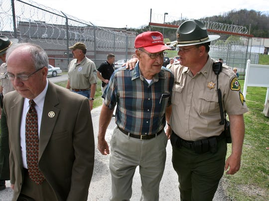 Former Williamson County Sheriff Fleming Williams, center, talks with Sgt. Sammie Baker, right, as they walk with Sheriff Jeff Long after the Williamson County Weapons Training Center in Franklin was dedicated and named for Williams on March 24, 2009.