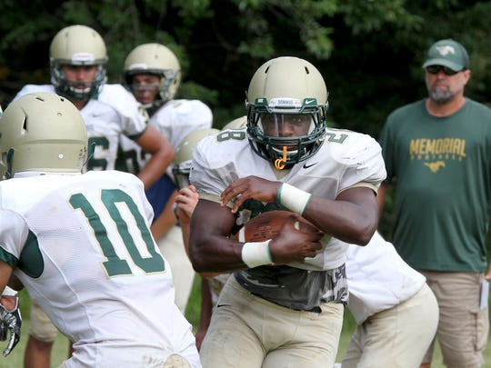 Brick Memorial's Tony Thorpe Jr. runs with the ball during practice Wednesday, August 24, 2017.