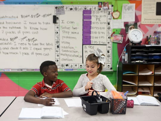 Frederic Hamler and Selena Dean, third graders at Glenn O. Swing Elementary School, in Covington, work together on an assignment in Tara Macke's math class.