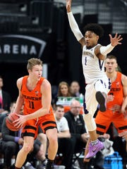 Washington's David Crisp guards Oregon State's Zach