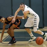 Mamaroneck's Isaiah Thomas (12) and Yorktown's Ryan Hill (11) battle for a loose ball during boys basketball action at Yorktown High School Feb 12, 2016.