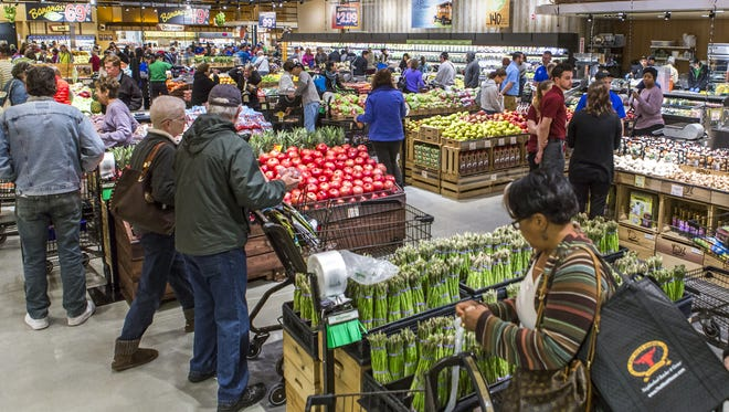 Customers file through the produce section after the opening of the new Wegmans grocery store in Concordville, Pa.