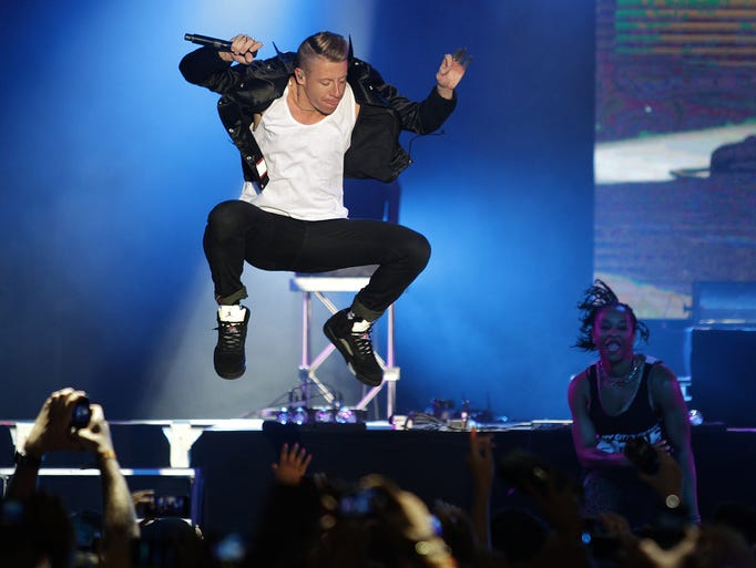 Macklemore performs on stage during the Monte Carlo Summer Festival in Monaco on Aug. 20, 2014.