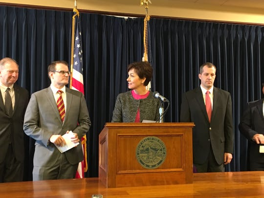 Gov. Kim Reynolds speaks Tuesday at a news conference at the Iowa Capitol