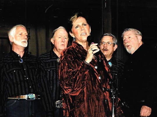 """Celebration Singers vocalist Dolores Compere and men's quartet members Don Jackson, Gene Linder, Larry Todsen and Bill Hughes present a rendition of the country hit """"Crazy."""""""