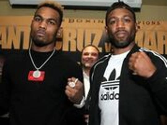 Jermell Charlo, left, and Austin Trout face off at a Los Angeles news conference.