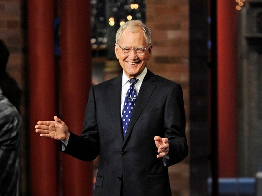 """In this image released by CBS, David Letterman appears during a taping of his final """"Late Show with David Letterman,"""" Wednesday, May 20, 2015 at the Ed Sullivan Theater in New York. After 33 years in late night television, 6,028 broadcasts, nearly 20,000 total guest appearances, 16 Emmy Awards and more than 4,600 career Top Ten Lists, David Letterman is retiring. (Jeffrey R. Staab/CBS via AP)"""