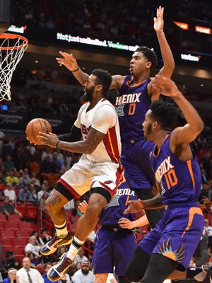 Mar 21, 2017: Phoenix Suns forward Marquese Chriss (0) fouls Miami Heat forward James Johnson (16) on the shot during the first half at American Airlines Arena.