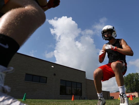 Stratford football players practice running before