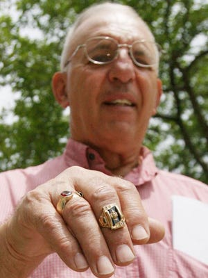Terry Long, a 1965 graduate of Meservey-Thornton High School shows the ring he lost in Mason City in 1967.  It was found and returned to him recently.