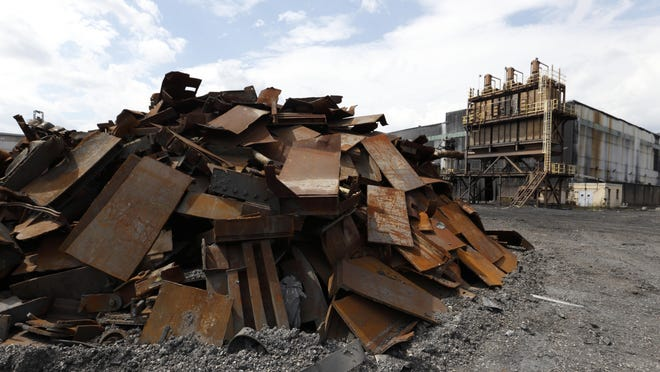 A pile of rubble lies next to the former Ormet aluminum plant in Hannibal, Ohio. For decades, the plant brought well-paying union jobs and generous benefits to the area. But due to stiff price competition from China, the plant closed in 2014.