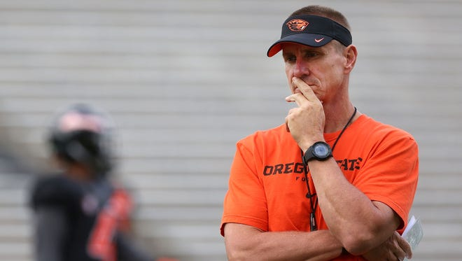 Oregon State head coach Gary Andersen watches drills during the first day of fall practice on Saturday, Aug. 8, 2015, in Corvallis, Ore.