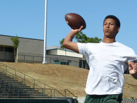 Photo by T.J. Holmes Red Bluff quarterback Kade Lewis fires a pass during spring practice.