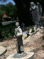 A statue of a military service member and an angel are displayed Hughes lawn Friday, May 25, 2018.